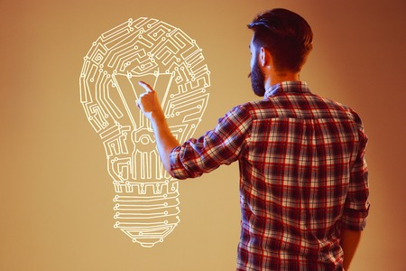 technology collage: Handsome young man with idea bulb on blue Stock Photo
