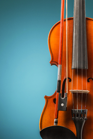 The violin front view on blue Stock Photo