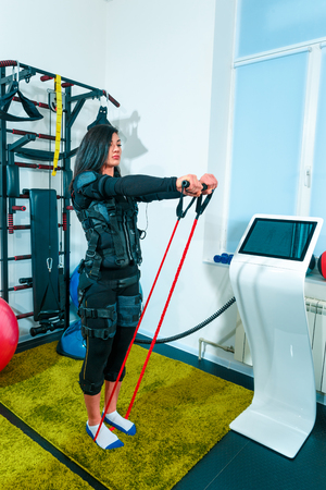 The female athlete doing they exercise in a ems fitness studio