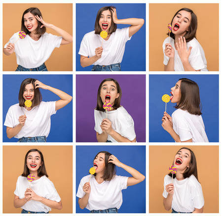 young woman with the colorful lollipop at studio Stock Photo