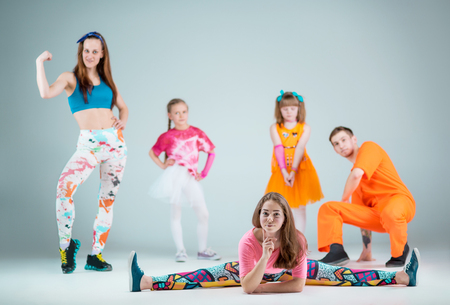 Group of man, woman and teens dancing hip hop choreography Stock Photo