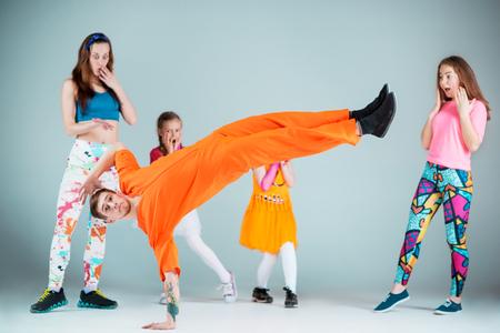 Group of man, woman and teens dancing hip hop choreography Stock Photo