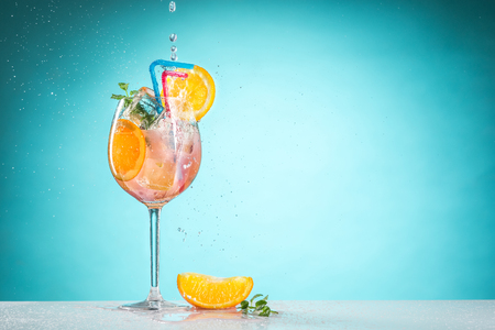 spritz: The rose exotic cocktail and fruit on blue Stock Photo