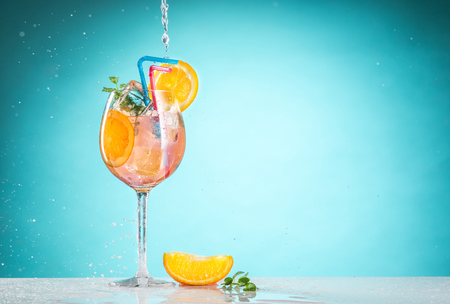The rose exotic cocktail and fruit on blue Stock Photo