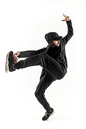 acrobacia: The silhouette of one hip hop male break dancer dancing on white background Foto de archivo