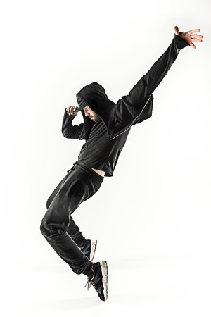 The silhouette of one hip hop male break dancer dancing on white background 版權商用圖片