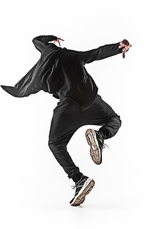 The silhouette of one hip hop male break dancer dancing on white background Stock Photo - 75166303