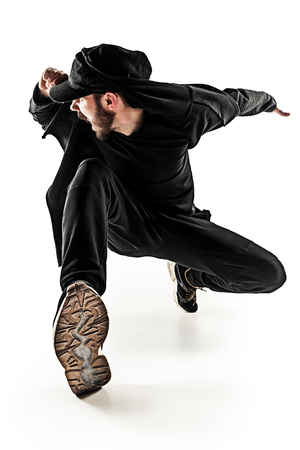 The silhouette of one hip hop male break dancer dancing on white background Stock Photo