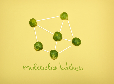 The pop art collage of Chemical molecule structure and fresh Brussels sprouts on yellow Stock Photo