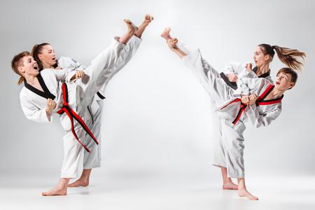 The studio shot of group of kids training karate martial arts Foto de archivo