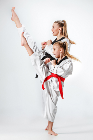 The studio shot of group of kids training karate martial arts Stok Fotoğraf - 75551500
