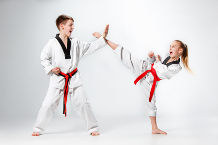 The studio shot of group of kids training karate martial arts Stock Photo
