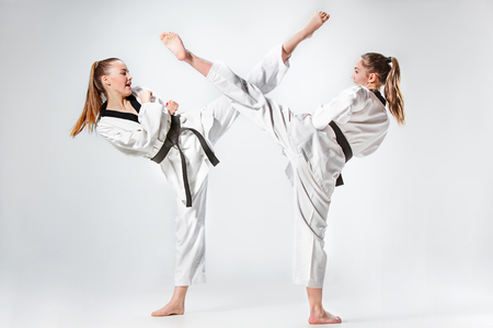 The studio shot of group of kids training karate martial arts 版權商用圖片