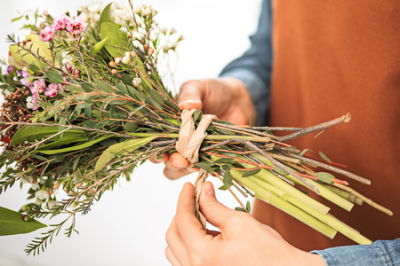 Florist at work: the female hands of woman making fashion modern bouquet of different flowers Stock Photo