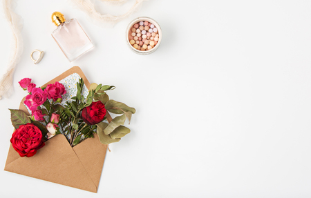 Love or valentines day concept. Red beautiful roses in envelopen
