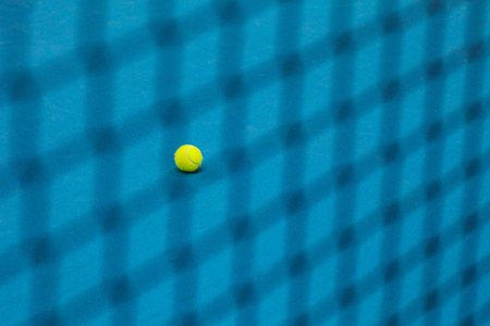 The tennis ball on a tennis court Stock Photo