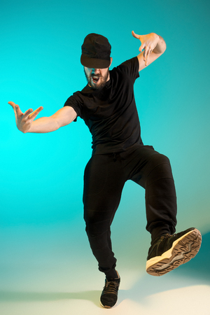 The silhouette of one hip hop male break dancer dancing on colorful background Stock Photo