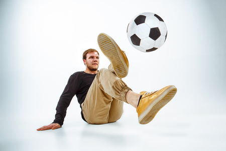 A portrait of a fan with ball on gray studio background. Freestile concept Stock Photo