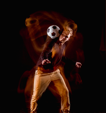A portrait of a fan with ball on gray studio background. Freestile Stock Photo