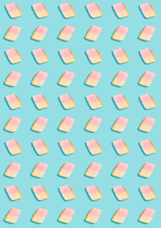 white marshmallows on a blue background. geometric pattern of white marshmallows. top view