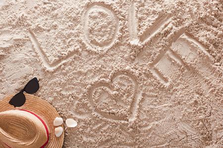 The word Love written in a sandy tropical beach