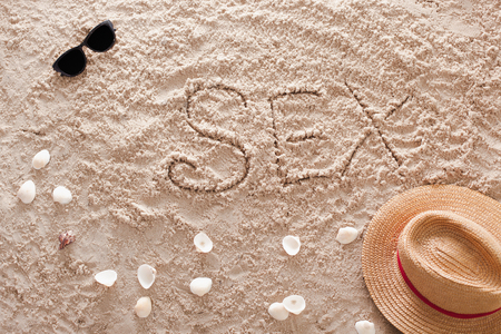 The word Sex written in a sandy tropical beach Stock Photo