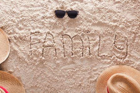 The word Family written in a sandy tropical beach Stock Photo