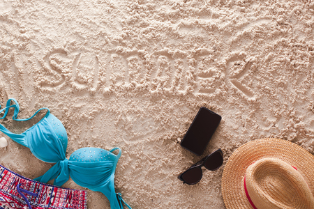 The word Summer written in a sandy tropical beach Stock Photo