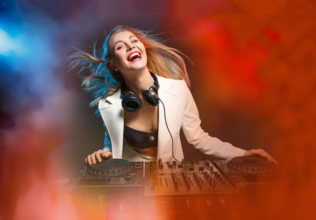 Beautiful blonde DJ girl on decks - the party, Stock Photo