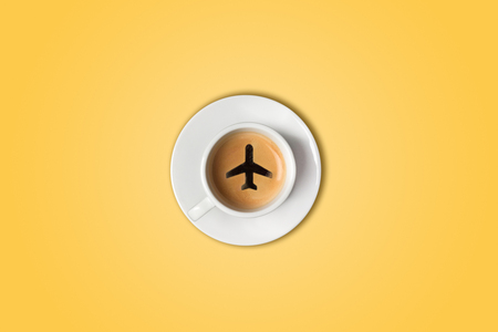 The travel concept. The airport coffee cup. Top view