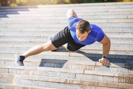 Fit man doing exercises outdoors at park Stok Fotoğraf - 80130968