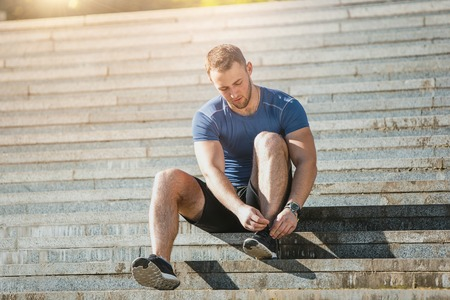 Fit man doing exercises outdoors at park Stok Fotoğraf - 80130982