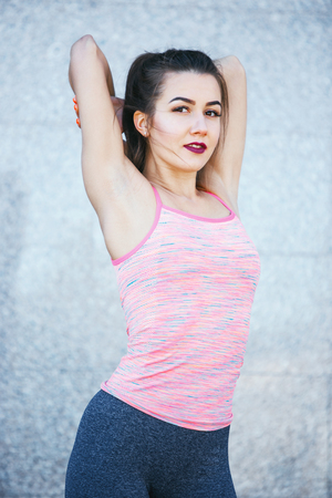 Fit fitness woman doing stretching exercises outdoors at park Stok Fotoğraf