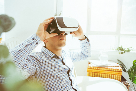simulator: The man with glasses of virtual reality. Future technology concept.