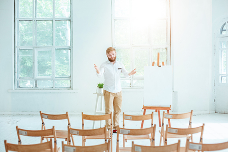 Speaker at Business Meeting in the empty conference hall. Stock Photo