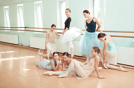 a rehearsal: The seven ballerinas at ballet bar