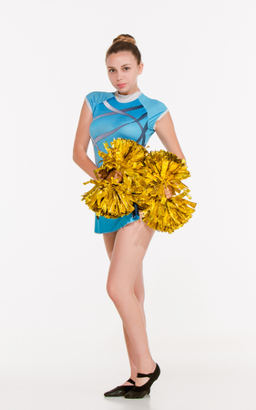 black cheerleader: The teen cheerleader posing at white studio