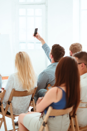 The people at Business Meeting in the conference hall. Stock Photo