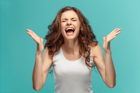 Portrait of young woman with shocked facial expression Stock Photo - 80857383