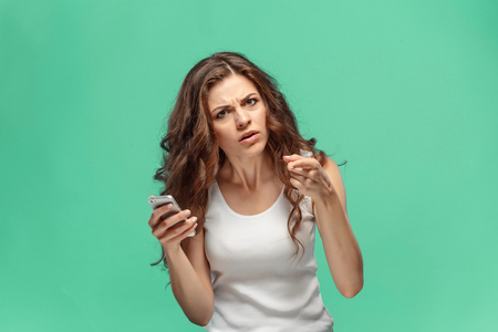 The portrait of disgusted woman with mobile phone Banco de Imagens