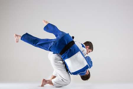 The two judokas fighters fighting men Banco de Imagens