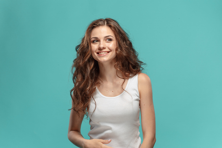 The young womans portrait with happy emotions
