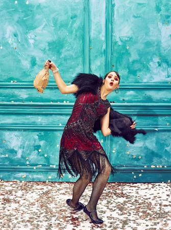 The studio shot of woman as retro dancer