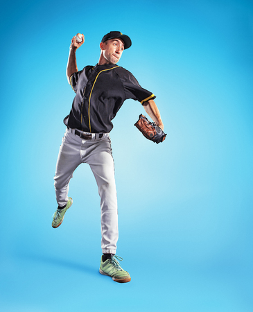 The one caucasian man as baseball player playing against blue sky Standard-Bild