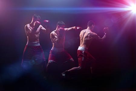 The boxer boxing in a dark studio