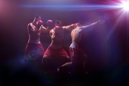 The boxer boxing in a dark studio Stock Photo - 81801667