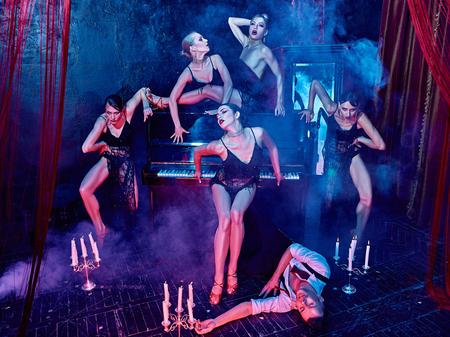 The studio shot of group of retro dancers