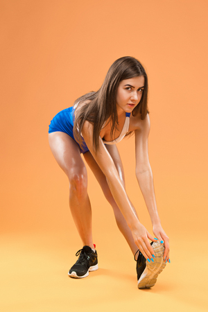 Muscular young woman athlete posing at studio Stock Photo