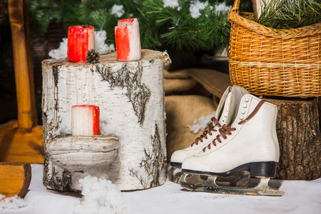 Vintage ice skates for figure skating with fir tree branch hanging on rustic background. Stock Photo - 82701270