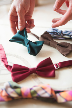 The male hand choosing hand made bow ties Stock Photo